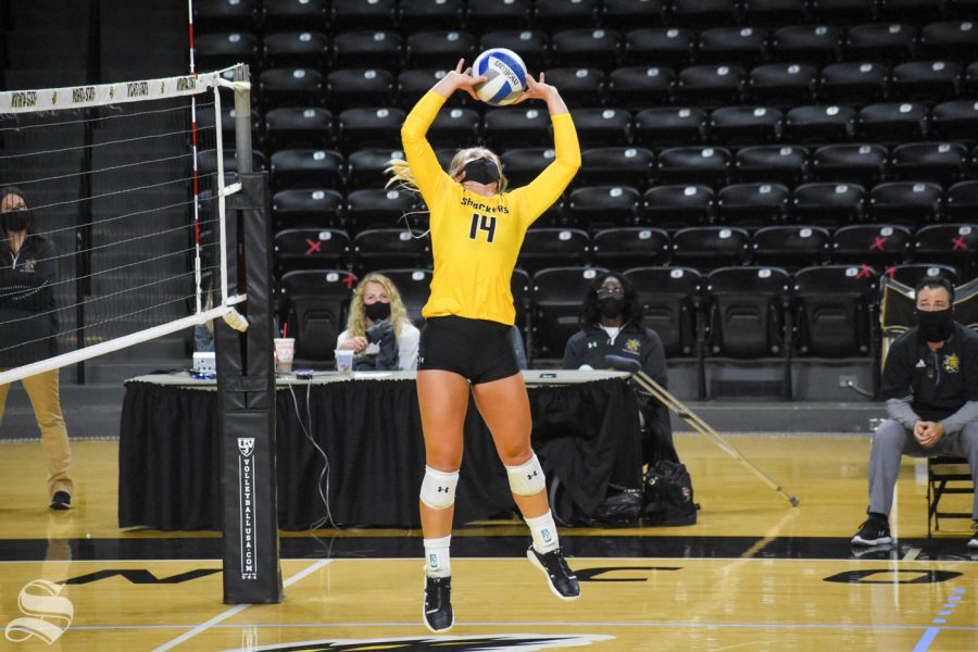 Senior McKayla Wuensch sets the ball during the fourth set of the Black and Yellow Scrimmage on Friday.