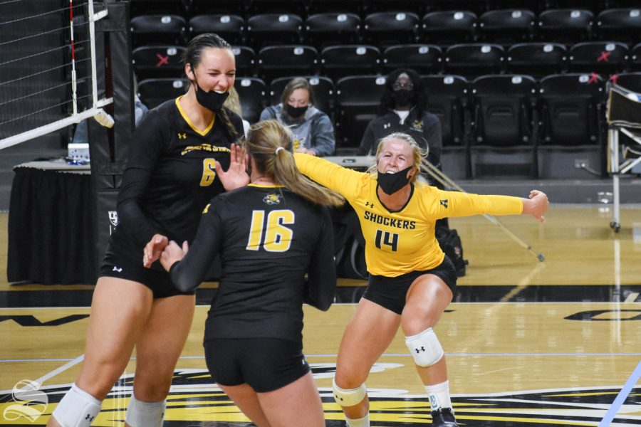 Wichita State's McKayla Wuensch celebrates with her teammates after scoring against the yellow team in the fourth set of the Black and Yellow scrimmage on Friday.