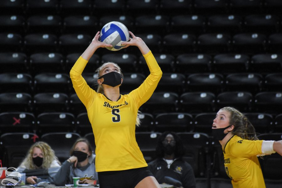 Wichita State's Kaycee Litzau sets the ball during the fifth set of the Black and Yellow Scrimmage on Friday inside Charles Koch Arena.