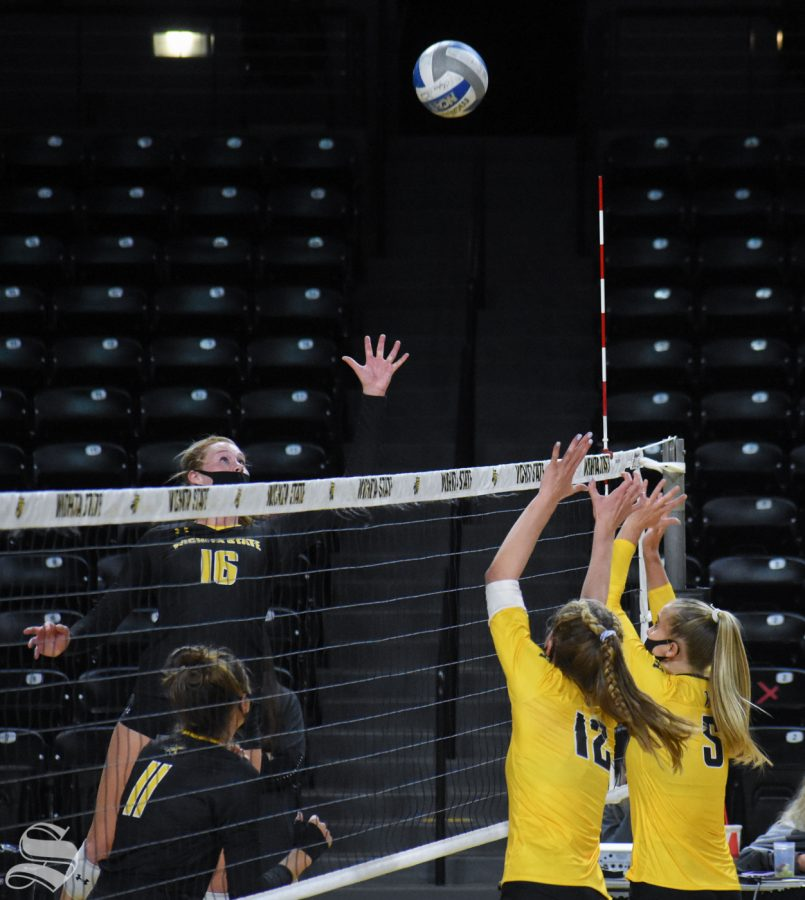 Wichita State freshman Marriah Buss goes up for a tip ball at the net during the fifth set of the Black and Yellow Scrimmage on Friday.