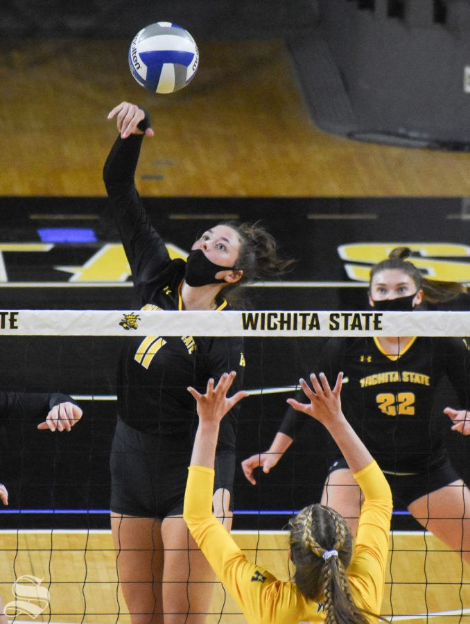Freshman Natalie Foster spikes the ball during the second set of the Black and Yellow Scrimmage on Friday. The black team won the scrimmage 3-2.