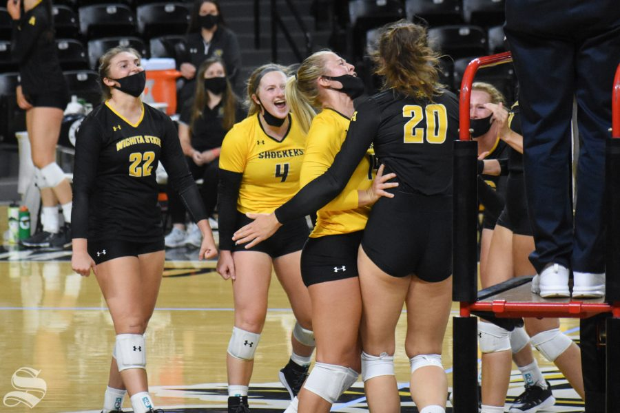 The black team celebrates after scoring against the black team during the scrimmage on Friday, Oct. 16 inside Charles Koch Arena.