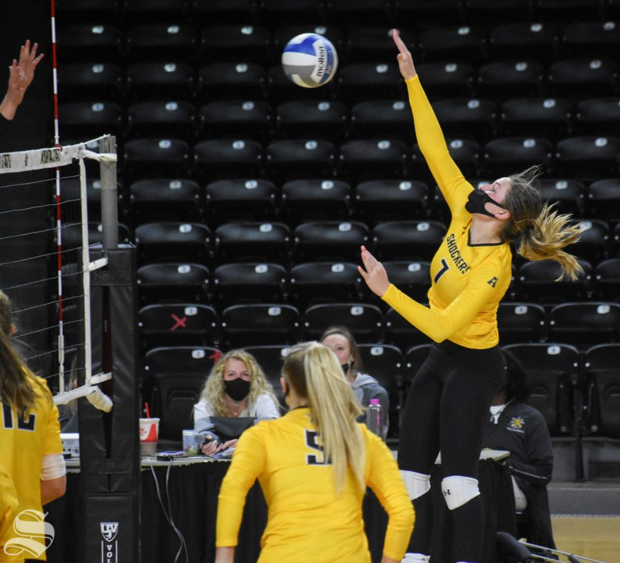 Sophomore Nicole Anderson spikes the ball during the Black and Yellow Scrimmage on Friday inside Charles Koch Arena.