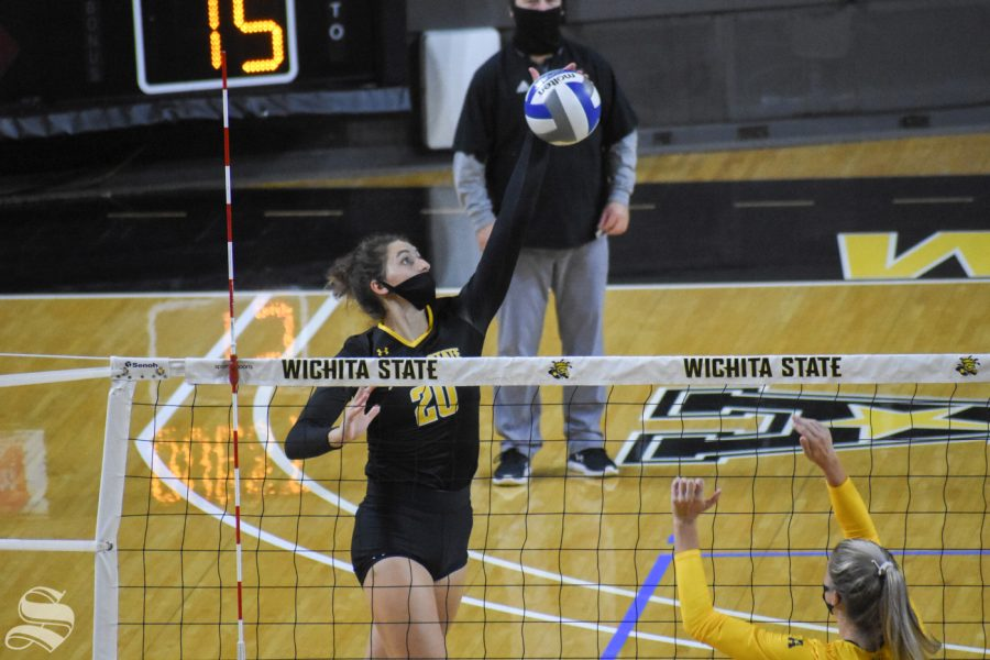 Sophomore Sophia Rohling goes up for a spike during the scrimmage on Friday. The black team won in five sets, 3-2.