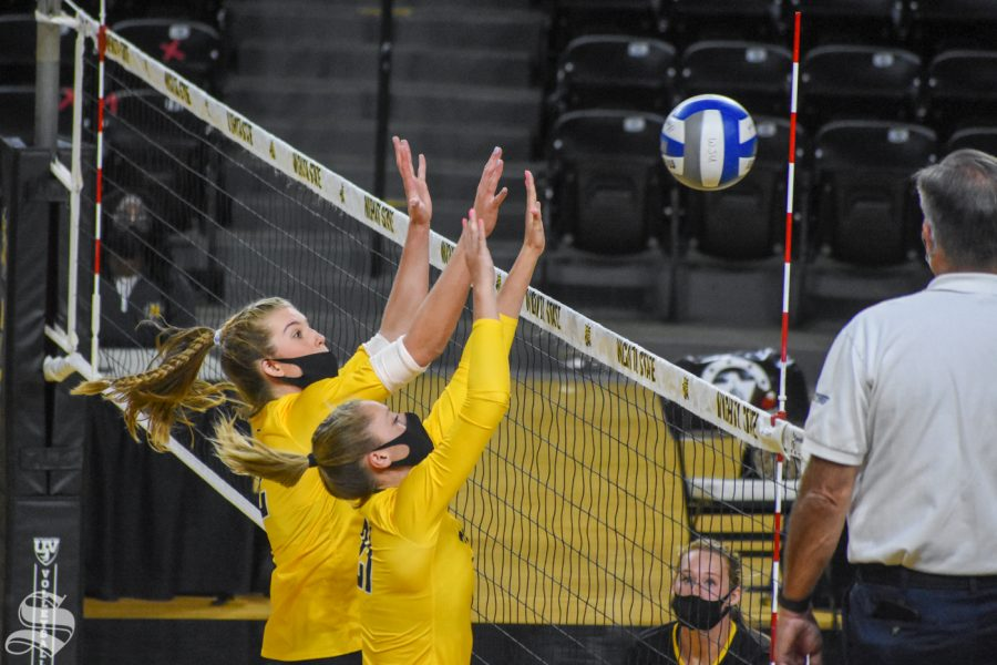 Wichita States Lauren McMahon and Megan Taflinger go up for a double block during the Black and Yellow Scrimmage on Friday, Oct. 16 inside Charles Koch Arena.