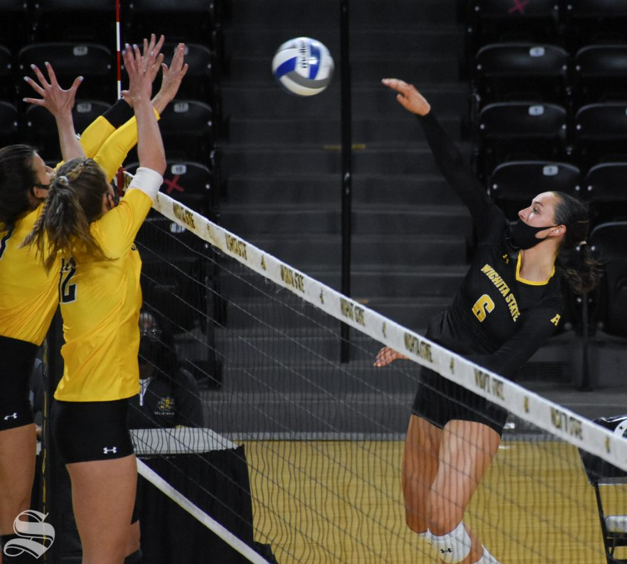 Wichita States Emma Wright hits the ball over to the yellow team during the Black and Yellow Scrimmage on Friday inside Charles Koch Arena.