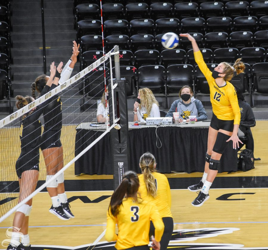 Wichita State freshman Lauren McMahon spikes the ball to the black team during the Black and Yellow Scrimmage on Friday inside Charles Koch Arena. The black team won in five sets, 3-2.