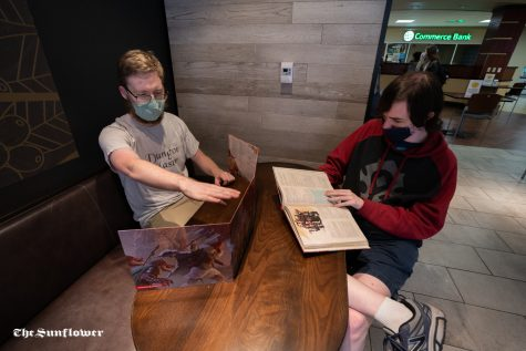 Eldon Taskinen (left) and Tyler Gardner (right) talk about the game. WSUs Dungeon and Dragon club was formed in the Spring of 2019.
