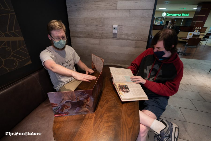 Eldon Taskinen (left) and Tyler Gardner (right) talk about the game. WSU's Dungeon and Dragon club was formed in the Spring of 2019.