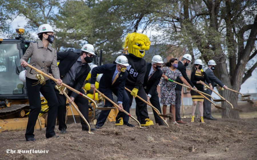 The groundbreaking celebration's speakers begin to dig during the groundbreaking celebration for Wayne and Kay Woolsey Hall on Oct. 22.