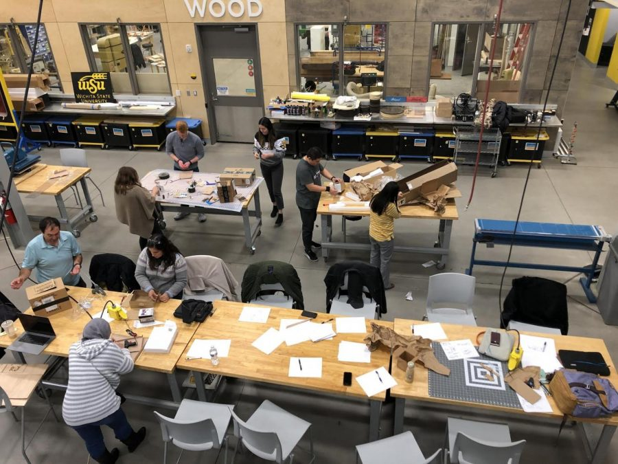Students from the ID 752 Prototyping course use cardboard boxes to build toasters for an activity.