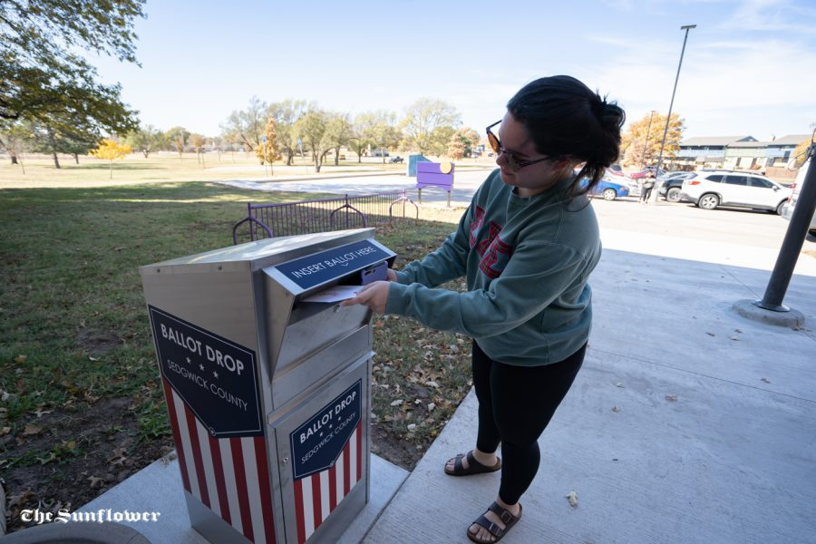 Mikayla Haehn drops off her ballot at Boston Recreation Center on Tuesday.