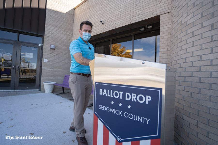 Josh Stepp drops off his ballot at Boston Recreation Center on Tuesday.