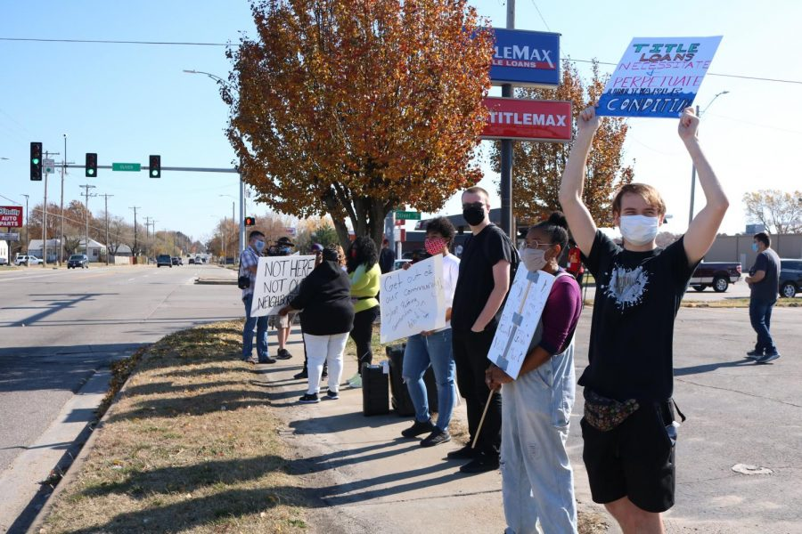 Wichita citizen's and Wichita State students were protesting TitleMax and other loan businesses from entering their community and preying on low income communities on Nov. 7.