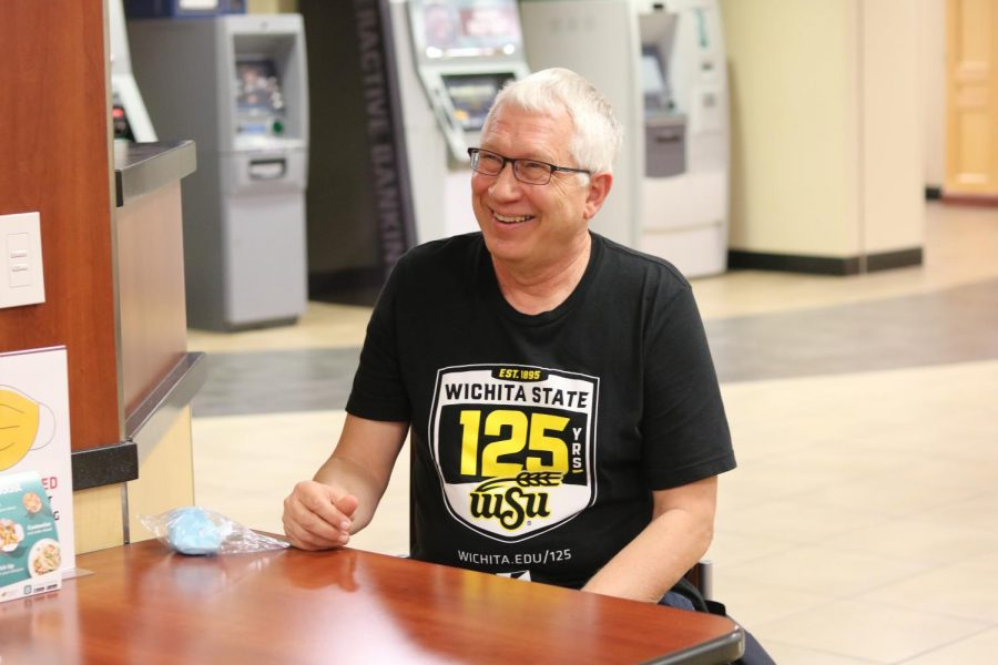Joe Kleinsasser laughs during an interview with The Sunflower at the Rhatigan Student Center on Monday, Nov. 8. Kleinsasser, the co-director of News and Media Relations at the Strategic Communications office, is retiring in December after 34 years at WSU.