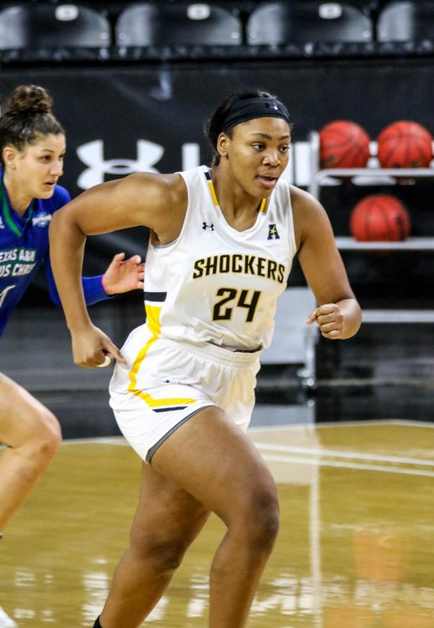 Wichita State junior,  Trajata Colbert runs across the court during a basketball game at Charles Koch Arena on Nov. 27.