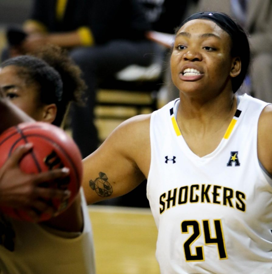 Wichita State junior, Trajata Colbert guards the ball during a basketball game at Charles Koch Arena on Nov. 27.