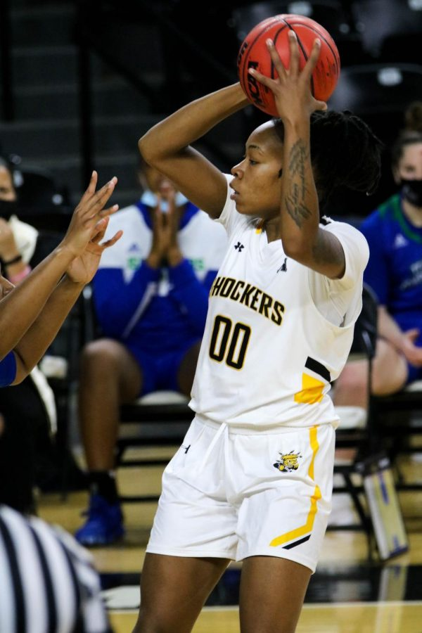 Wichita State junior, Asia Strong grabs the ball from her opponent during a basketball game at Charles Koch Arena on Nov. 27.