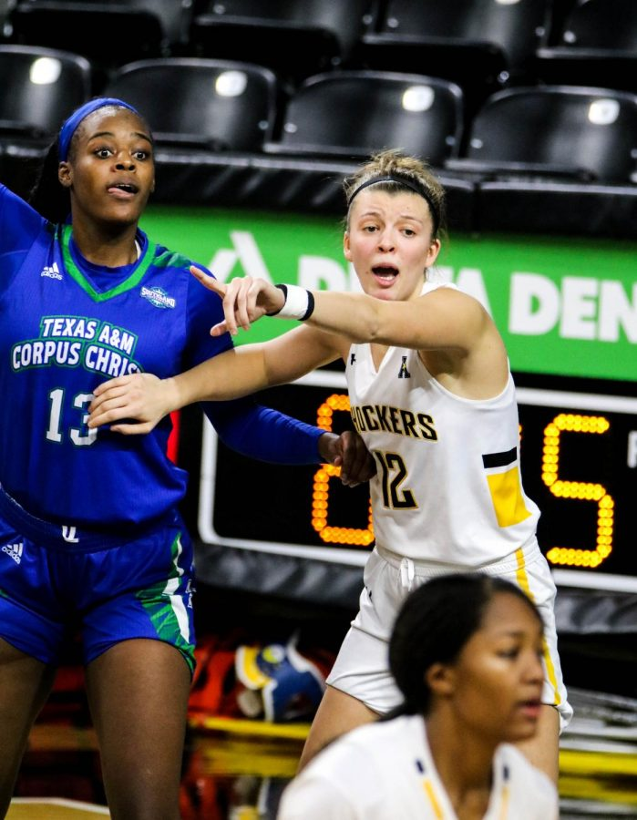 Wichita State junior, Carla Bremaud guards her opponent during a basketball game at Charles Koch Arena on Nov. 27.