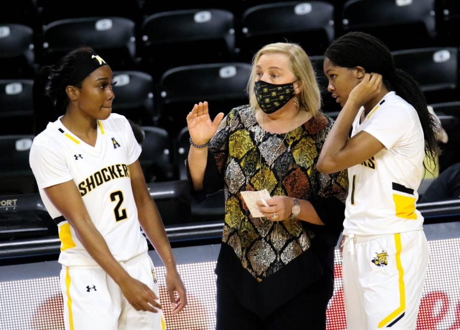 The Wichita State women's basketball coach, Keitha Adams talks to her team during a basketball game at Charles Koch Arena on Nov. 27.