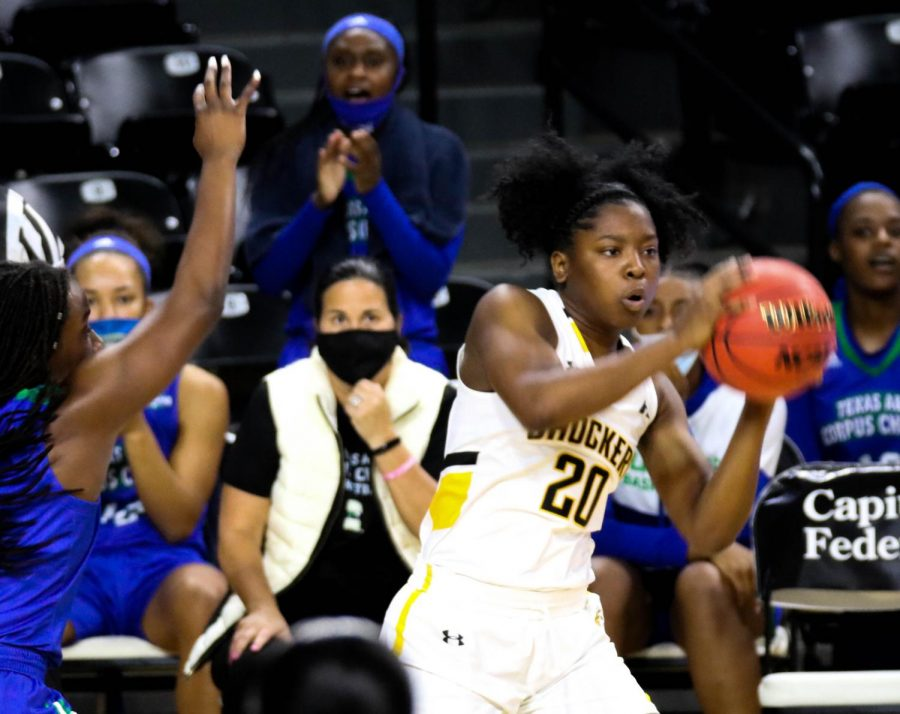 Wichita State freshman, Shamaryah Duncan grabs the ball during a basketball game at Charles Koch Arena on Nov. 27.