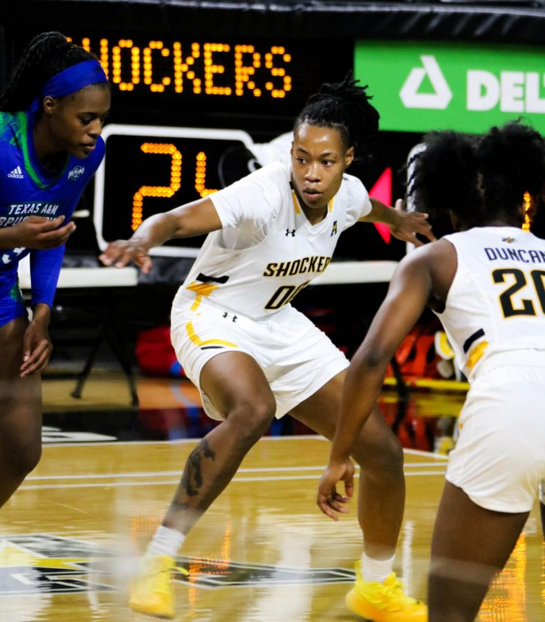 Wichita State junior, Asia Strong guards her opponent  during a basketball game at Charles Koch Arena on Nov. 27.