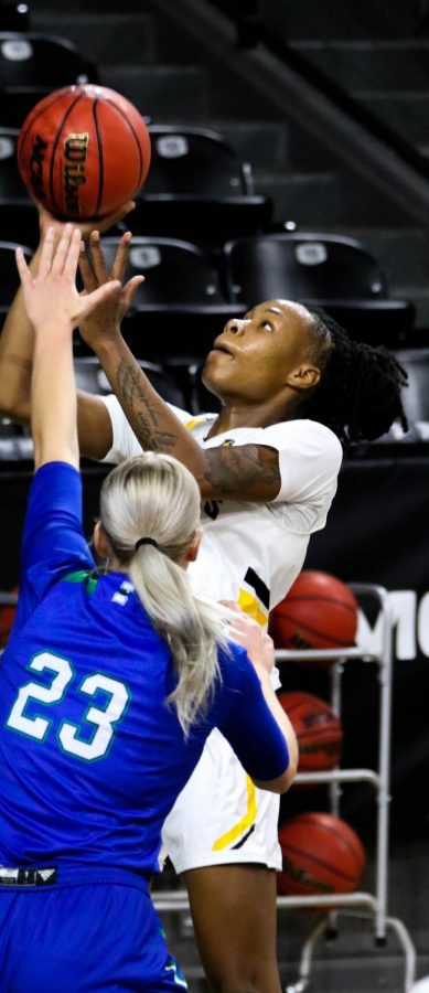 Wichita State junior, Asia Strong shoots the ball during a basketball game at Charles Koch Arena on Nov. 27.