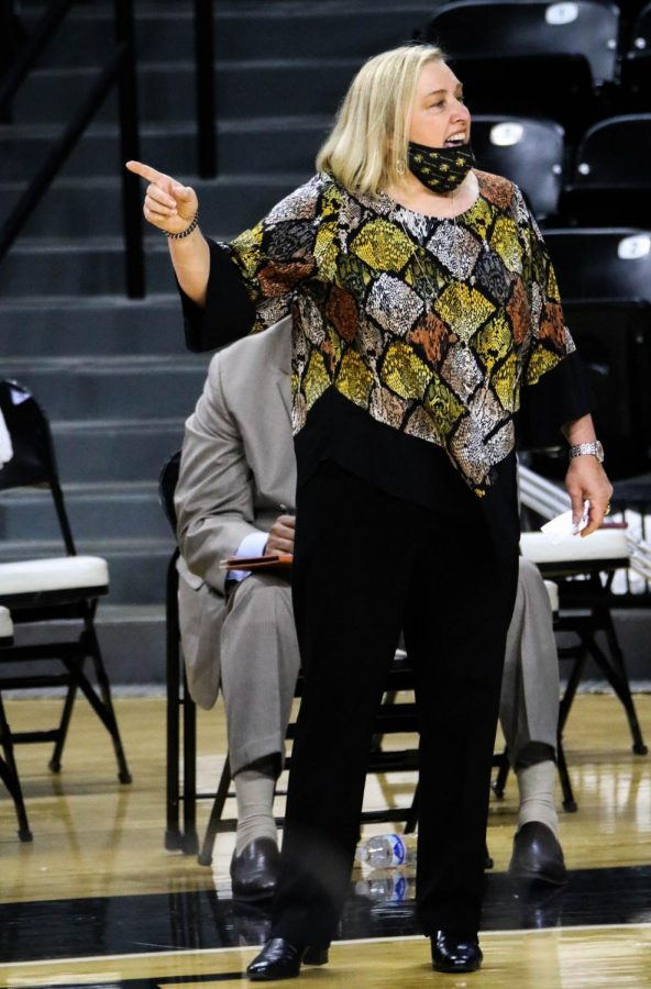 Wichita State women's head basketball coach, Keitha Adams communicates with her team during a game at Charles Koch Arena on Nov. 27.