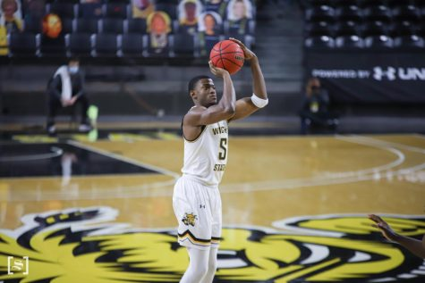 Wichita State senior Trey Wade shoots a three-pointer during a game against Missouri at Charles Koch Arena on Dec. 6.