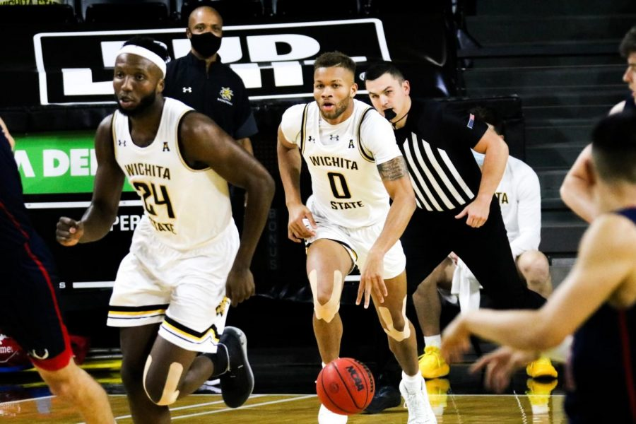 Junior Dexter Dennis dribbles up the court in the Shockers' game against Newman University on Dec. 30 inside Charles Koch Arena.