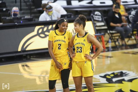 Wichita State senior Mariah McCully talks to junior Seraphine Bastin during the game against Northern Iowa on Dec. 6 at Koch Area.