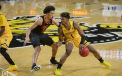 Wichita State sophomore Tyson Etienne looks to drive pass OSU freshman Cade Cunningham during the game at Charles Koch Arena on Dec.12.