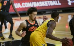 Oklahoma State freshman Cade Cunningham plays defense during the game against OSU at Charles Koch Arena on Dec.12.