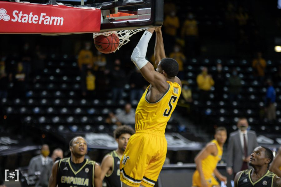 Wichita+State+senior+Trey+Wade+dunks+the+ball+during+the+game+against+ESU+at+Charles+Koch+Arena+on+Dec.+18.