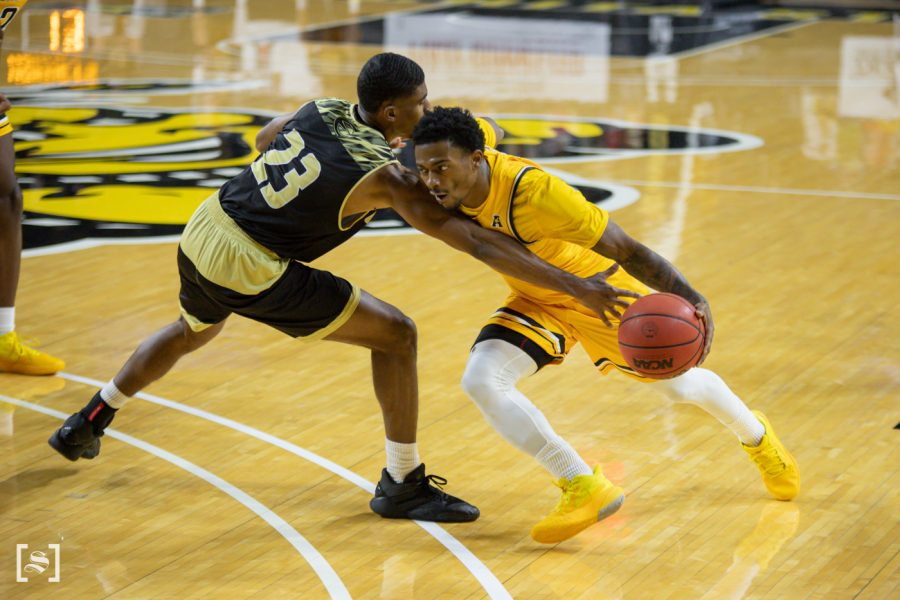 Wichita State redshirt senior Alterique Gilbert drives to the basket during the game against ESU at Charles Koch Arena on Dec. 18.