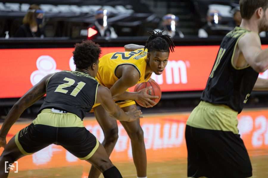 Wichita State freshman Jaden Seymour looks to pass during the game against ESU at Charles Koch Arena on Dec. 18.