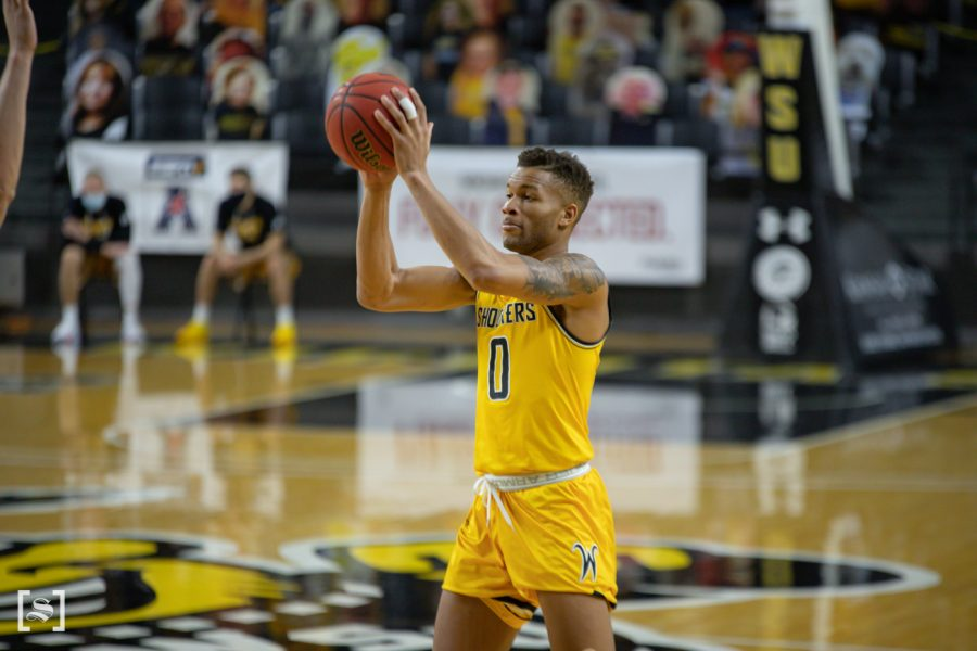 Wichita+State+junior+Dexter+Dennis+looks+to+pass+during+the+game+against+ESU+at+Charles+Koch+Arena+on+Dec.+18.
