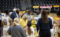 Head coach Keitha Adams talks to the team during the game against the South Dakota Coyotes at Charles Koch Arena on Dec. 10.