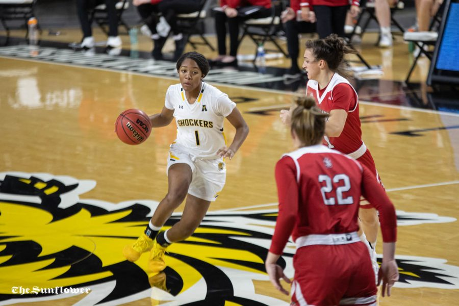 Wichita State sophomore DJ McCarty dribbles toward the basket during the game against the South Dakota Coyotes at Charles Koch Arena on Dec. 10.