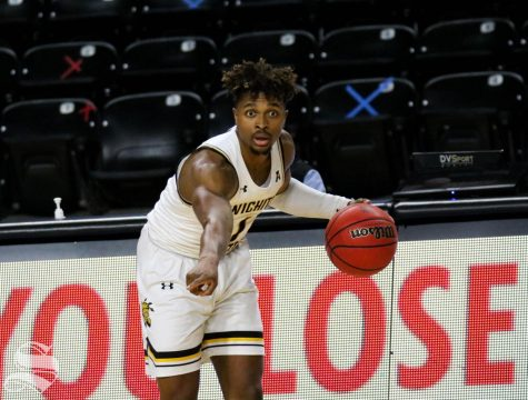 Wichita State sophomore, Tyson Etienne points to where his teammate should run to during a game against Oral Roberts University at Charles Koch Arena on Dec. 2.
