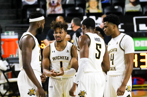 Wichita State sophomore, Tyson Etienne communicates the next play to his teammates during a game against Newman University on Dec. 30 at Charles Koch Arena.