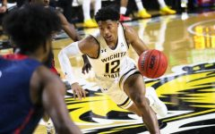 Wichita State junior, Trevin Wade dribbles the ball across the court during the game against Newman University at Charles Koch Arena on Dec. 30.