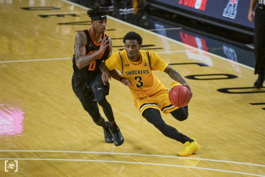 Redshirt senior Alterique Gilbert drives to the basket in WSU's game against Oklahoma State on Dec. 12 inside Charles Koch Arena.
