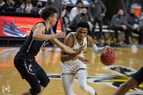 Wichita State freshman Ricky Council IV dribbles down the court during the game against the Cincinnati Bearcats at Charles Koch Arena on Jan. 10.
