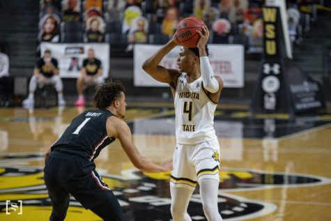 Wichita State freshman Ricky Council IV looks to pass during the game against the Cincinnati Bearcats at Charles Koch Arena on Jan. 10.