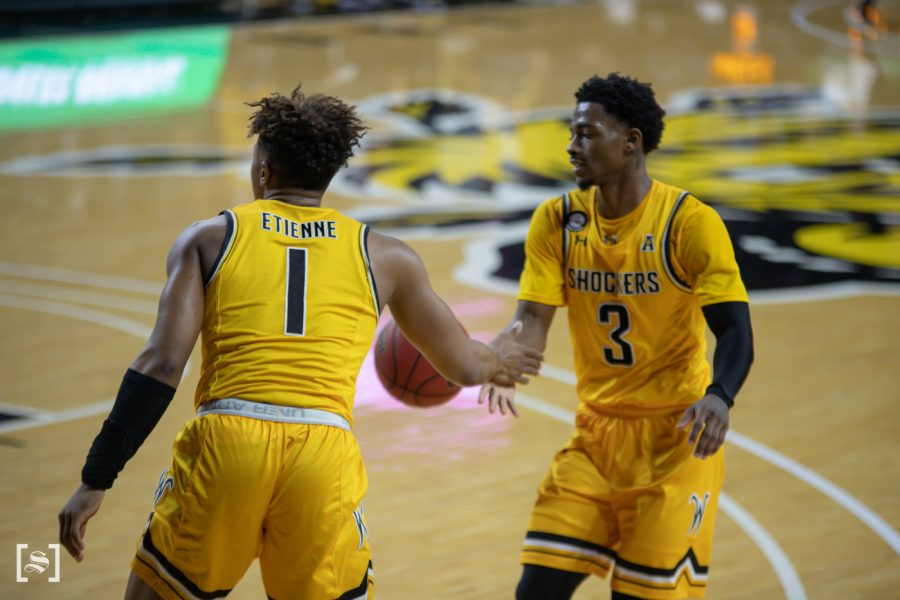 Wichita State Tyson Etienne dabs up Alterique Gilbert during the game against UCF at Charles Koch Arena on Jan. 30.