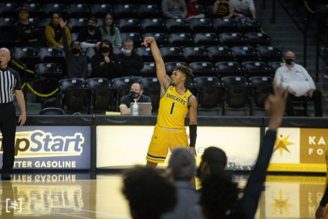 Wichita State sophomore Tyson Etienne follows through a 3 point shot during the game against UCF at Charles Koch Arena on Jan. 30.