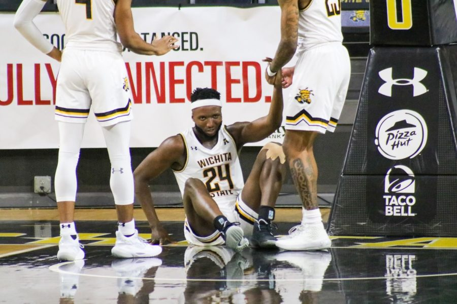 Morris Udeze celebrates with his teammates during WSU's game against Tulsa on Jan. 13 inside Charles Koch Arena.