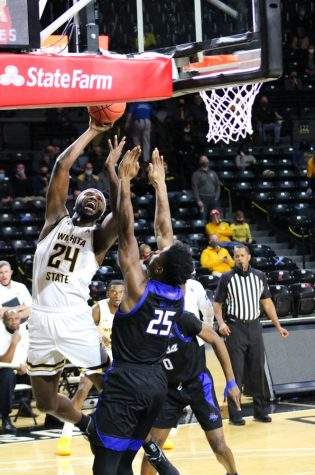 Wichita State junior, Morris Udeze tries to shoot a basket during a game against Tulsa at Charles Koch Arena on Jan. 13.