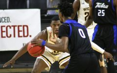 Wichita State senior, Trey Wade guards his opponent  during a game against Tulsa at Charles Koch Arena on Jan. 13.